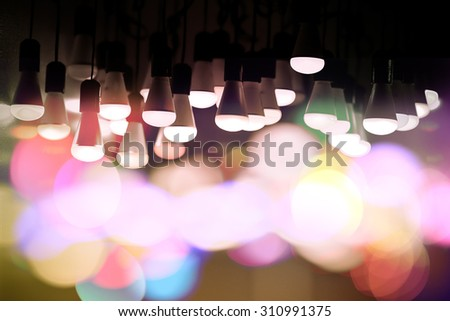 colorful light bulbs on a bokeh background - stock photo