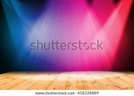 Colorful light on wooden floor background - stock photo