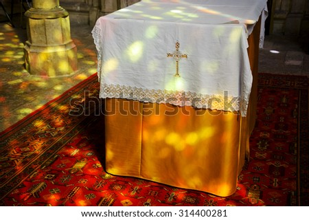 Colorful light spots on the altar and the floor in church. Sunlight filtered through the stained glass window. A game of light and shadow. - stock photo