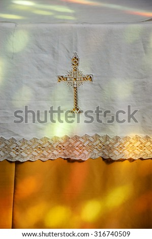 Colorful light spots on the altar  cover. Sunlight filtered through the stained glass window in church. A game of light and shadow. - stock photo