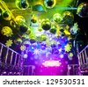 Colorful lights and disco balls decorations for Christmas at nightclub - stock photo