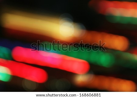 Colorful lights blur in motion on black - stock photo