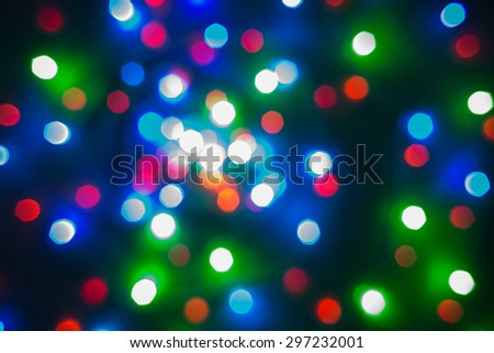 Colorful lights flying upwards on black background. Perfect background for typing any text. - stock photo