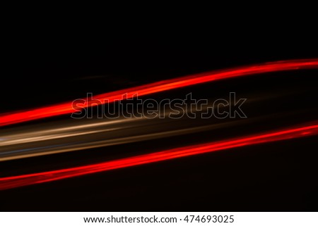 Colorful lights of urban surrounding blurred by motion