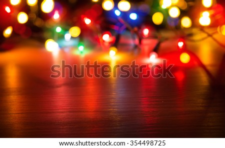 Colorful lights on red background - stock photo