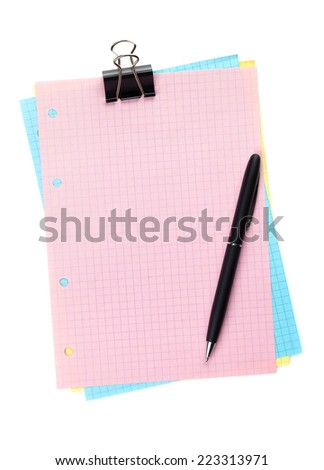 Colorful lined office paper with clip and pen. Isolated on white background - stock photo