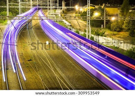 colorful lines moving railway carriage - stock photo