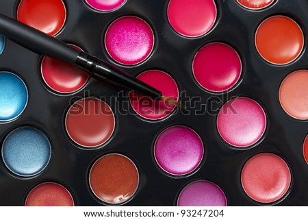 colorful lipstick palette and brush - stock photo