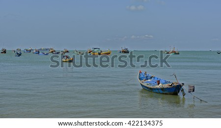 Colorful local fishing boats anchored in the bay at Vung Tau, Vietnam - stock photo