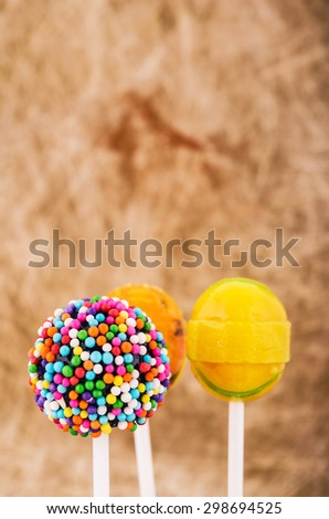 Colorful lollipop candy on a stick - stock photo