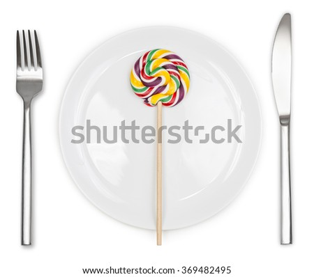 Colorful Lollipop in plate with knife and fork isolated on white background  - stock photo