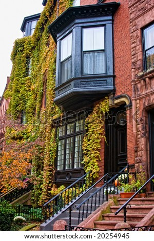 colorful lush foliage covering townhouses in beacon hill boston on a fall afternoon - stock photo