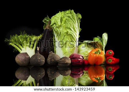 Colorful luxurious vegetable variation isolated on black background. - stock photo