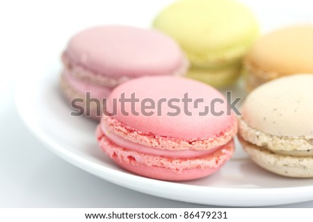 Colorful Macaron in close up isolated on white background - stock photo