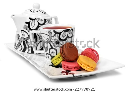 Colorful macarons and tea set - isolated on white background  - stock photo