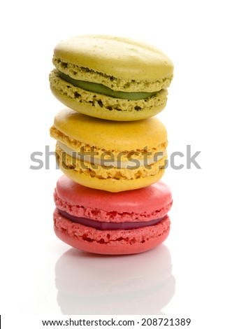 Colorful macarons flavored with matcha, lemon, and raspberry  - stock photo