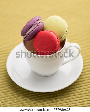colorful macarons on Napery background,macarons in a cup
