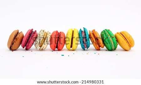 Colorful macarons on white background. Macaron is sweet meringue-based confection. - stock photo