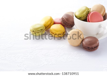 Colorful macaroons in a coffee cup