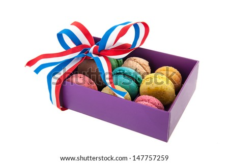 Colorful macaroons in carton gift box with ribbon - stock photo