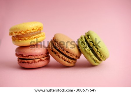 Colorful macaroons on pink
