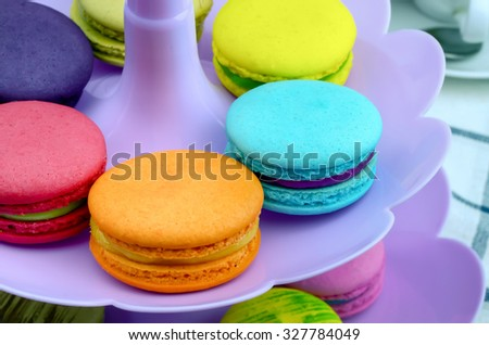 Colorful macaroons on purple plastic tray, Selective focus