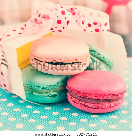 Colorful Macaroons on Retro Pastel Background. Sweet Meringue-Based Confection. Square Format. In Retro Tone Style.