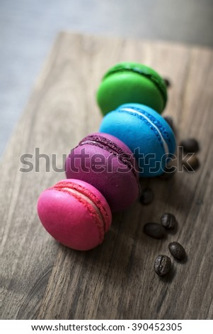 Colorful macaroons on wooden background, close up - stock photo
