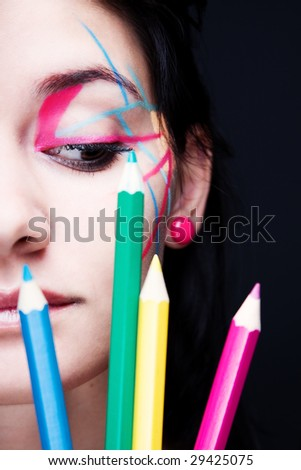 Colorful make-up with crayons decoration - stock photo