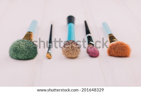 colorful makeup brushes on white background - stock photo