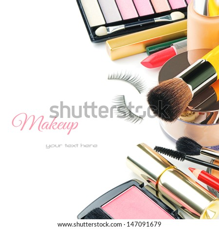 Colorful makeup products isolated over white - stock photo