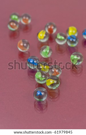 Colorful Marbles with Reflection on Glass - stock photo
