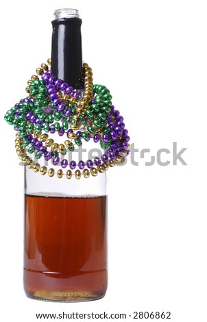 Colorful Mardi Gras Beads Around the Top of a Whiskey Bottle - stock photo