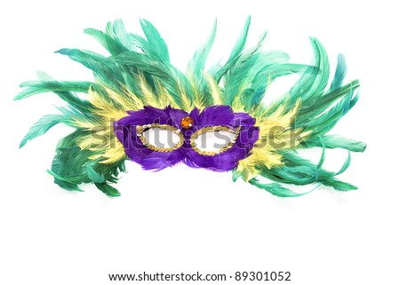 Colorful Mardi Gras mask of feathers isolated on white - stock photo