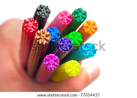 Colorful markers in hand, isolated on white. - stock photo