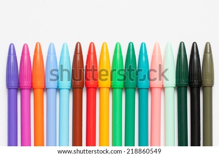 Colorful Markers Pens on White Background - stock photo