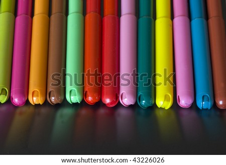 colorful markers with reflection