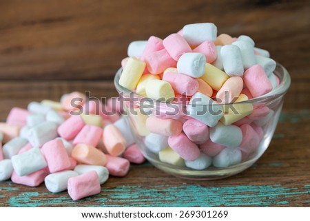 colorful marshmallows candy on wooden - stock photo