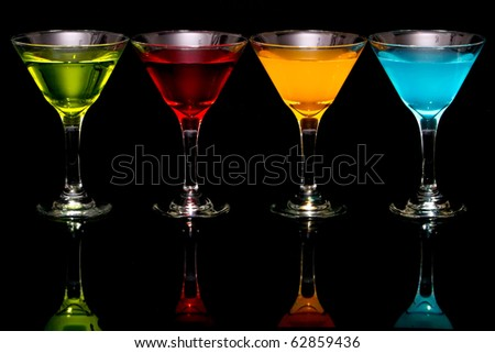 Colorful martini cocktail drinks in glasses - stock photo