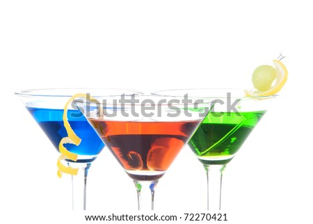 Colorful Martini Cocktails drink blue green and red on top composition with vodka, light rum, gin, tequila, blue curacao, lime juice in classic cocktail glasses isolated on a white background - stock photo
