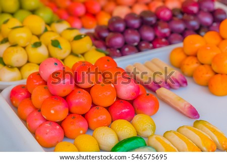 Colorful marzipan or almond paste candy made to look like fruits and vegetables and a market in Nice, France.