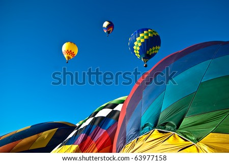 Colorful mass hot air balloon ascension - stock photo