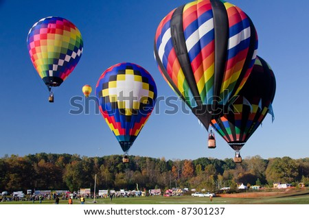 Colorful mass hot air balloons colliding in the air - stock photo