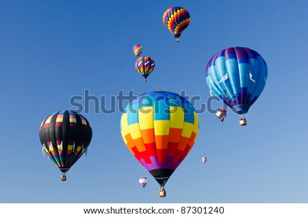 Colorful mass hot air balloons in the air - stock photo