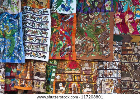 Colorful materials - market in Chichicastenango, Guatemala. - stock photo