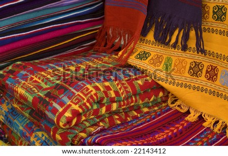 Colorful Mayan and Mexican Fabrics for sale in a Market in Chiapas, Mexico - stock photo