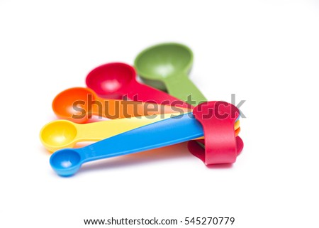 colorful measuring spoons isolated on white