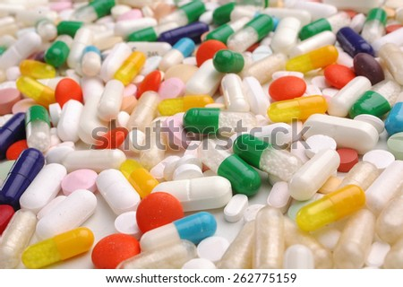 colorful medicine pills on white background - stock photo