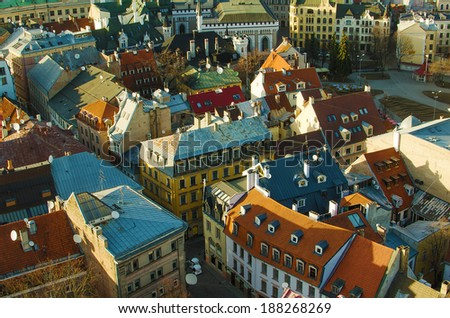 Colorful medieval Old Town of Riga (Latvia, Baltic States, European Union)  in the evening.  Aerial view from tower of St.Peter's Church - stock photo