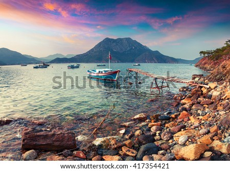 Colorful Mediterranean seascape in Turkey. Dramatic spring scene in Adrasan bay with view of Moses Mountain. Artistic style post processed photo. - stock photo